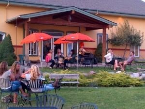 People enjoying wine outdoors at Ten Spoon Vineyard and Winery