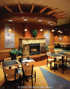 Relaxing dining area with fireplace at The Good Food Store