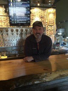 JC at the bar at Bandit Brewing