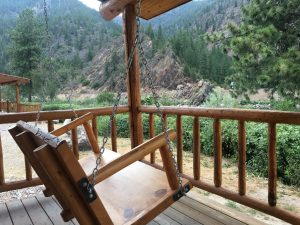 Porch Swing at Luxury River View Cabin at Quinn's Hot Springs Resort