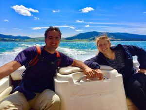 Two people enjoying a boat ride, with Big Arm Boat Rentals and Rides