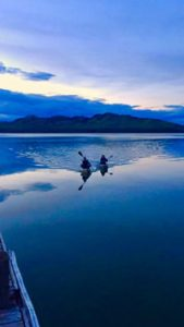 Kayakers on smooth water with Big Arm Boat Rentals and Rides