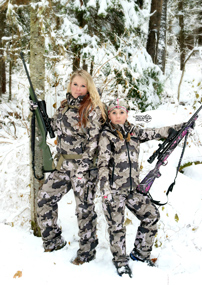 Rocky Mountain Front woman and girl in camo gear in snow, hunting