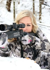 Rocky Mountain Front woman in camo gear hunting with rifle