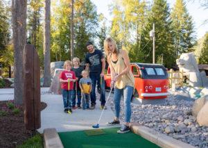 Family enjoying mini golf