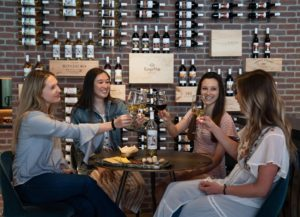 women raising a toast with wine glasses
